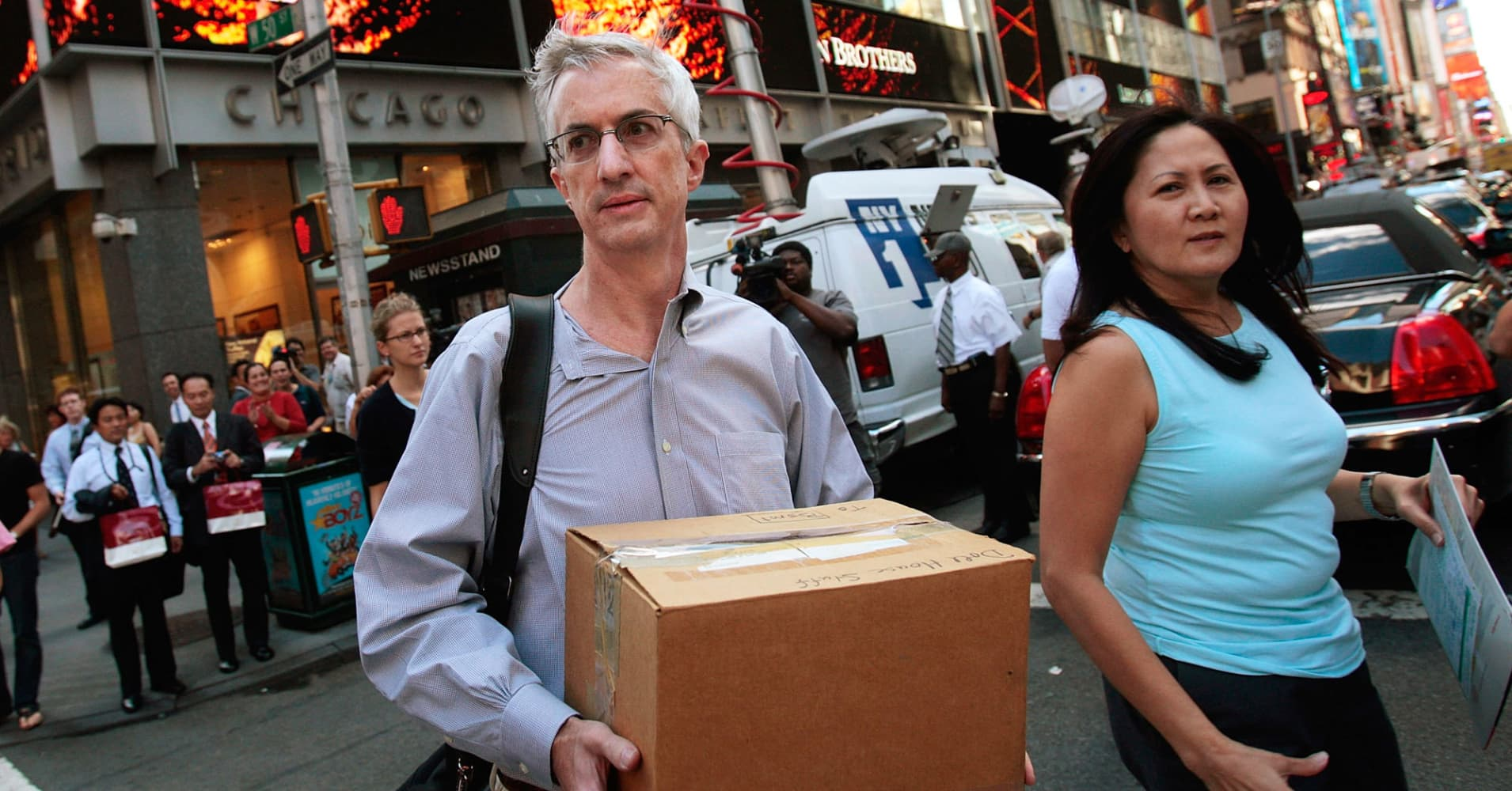 An employee of Lehman Brothers Holdings carries a box out of the company's headquarters building (background) September 15, 2008 in New York City. Lehman Brothers filed a Chapter 11 bankruptcy petition in U.S. Bankruptcy Court after attempts to rescue the storied financial firm failed.