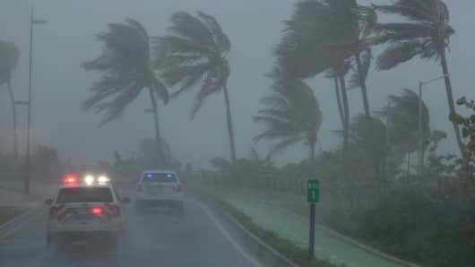Police patrol the area as Hurricane Irma slams across islands in the northern Caribbean on Wednesday, in San Juan, Puerto Rico September 6, 2017.