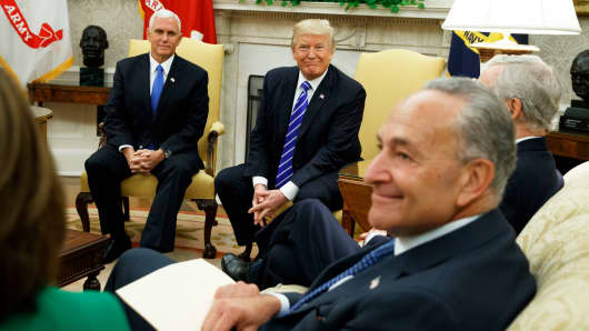 Vice President Mike Pence looks on with President Donald Trump during a meeting with Senate Minority Leader Chuck Schumer, D-N.Y., and other Congressional leaders in the Oval Office of the White House, Wednesday, Sept. 6, 2017, in Washington.