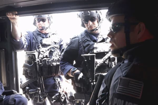 Officers ride to a training site near LAX.