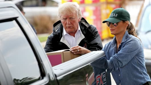 President Donald Trump and first lady Melania Trump load emergency supplies into the bed of a pickup truck for residents impacted by Hurricane Harvey while visiting the First Church of Pearland September 2, 2017 in Pearland, Texas.