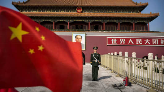 A Chinese soldier stands guard in front of Tiananmen Gate outside the Forbidden City in Beijing, China.