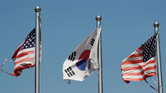 A South Korean national flag, center, and U.S. national flags fly at the Imjingak pavilion near the demilitarized zone (DMZ) in Paju, South Korea, on Saturday, April 29, 2017.