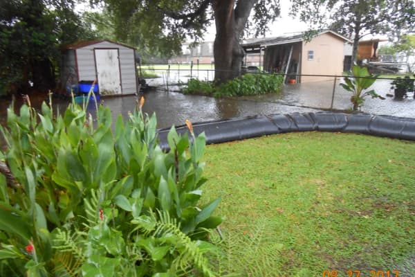 A $3,000 AquaDam protects the home of Helen Dore in Iberia Parish, Louisiana.