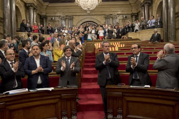 Deputees of Junts Pel Sí and CUP applaud during the debate to prove the Independence Referendum Law in Barcelona of Catalonia's Parliament in Barcelona, Spain on September 6, 2017.
