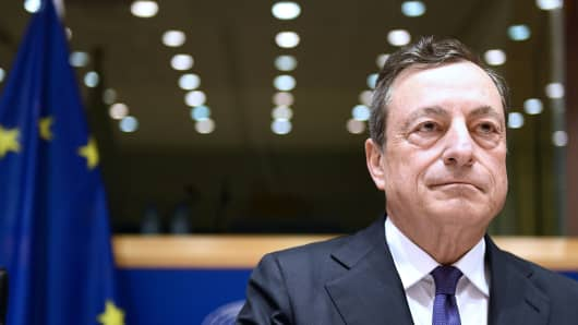ECB President Mario Draghi reacts as he delivers a speech during a meeting of the Committee on economic and monetary affairs (ECON) at the European Parliament, in Brussels, on May 29, 2017.