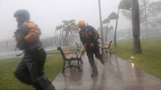 Members of the civil defense run as Hurricane Irma howls past Puerto Rico after thrashing several smaller Caribbean islands, in Fajardo, Puerto Rico September 6, 2017.