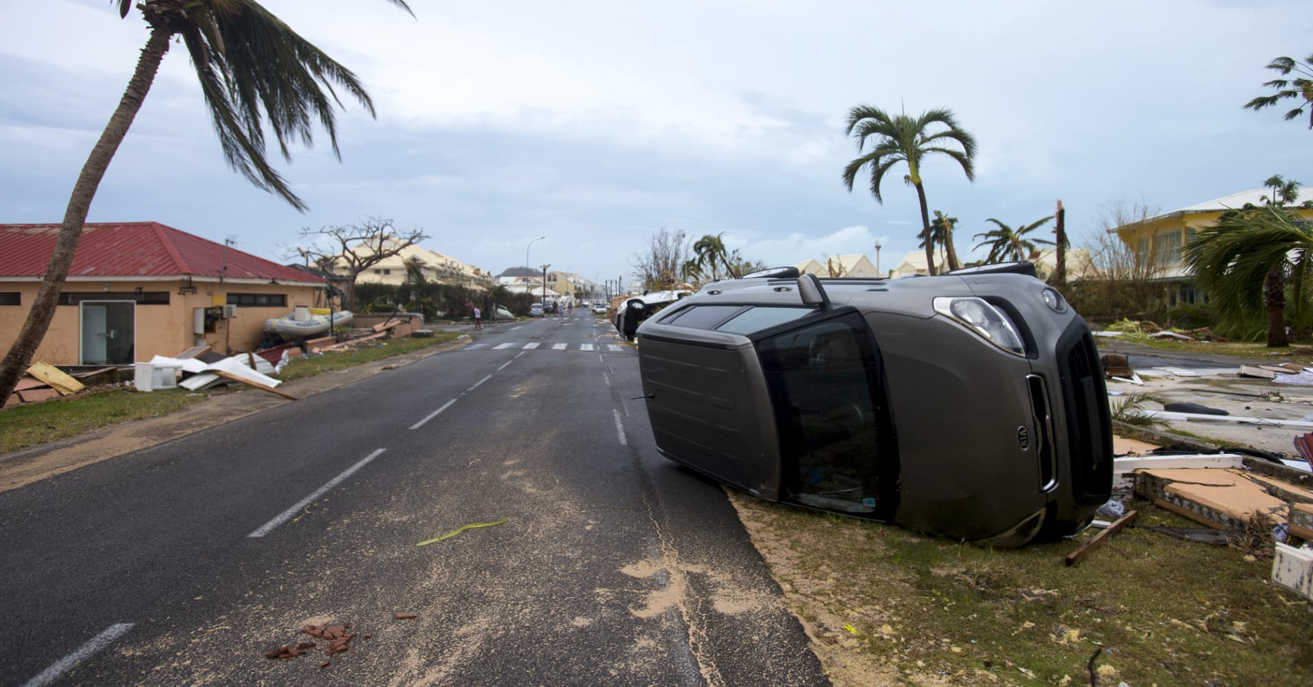 A car turned onto its side in Marigot, near the Bay of Nettle, on the French Collectivity of Saint Martin, after the passage of Hurricane Irma.