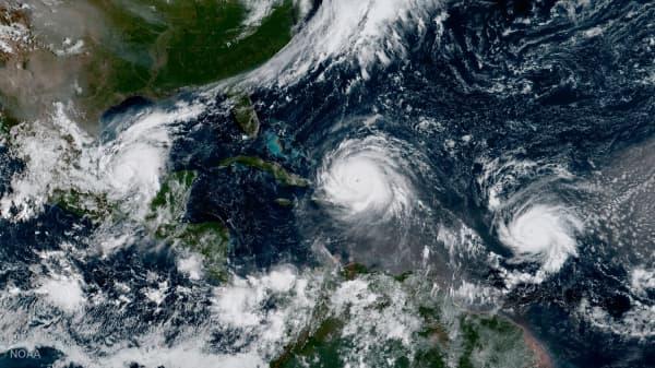 Hurricane Irma, Hurricane Jose (R) and Hurricane Katia (L) are pictured in the Atlantic Ocean in this September 7, 2017 NOAA satellite handout photo.