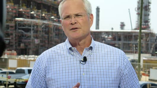 Darren Woods, Chairman and CEO, Exxon Mobil.