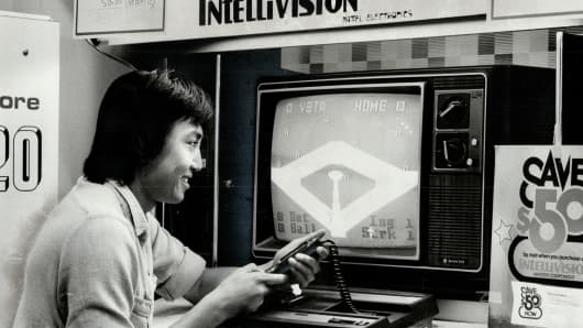Abang Adzhar, 22, tests his skill on an Intellivision video baseball game in 1982.