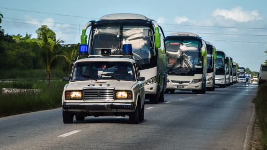 Police escort a convoy of buses carrying tourists evacuated from Caibarien, Villa Clara province in central Cuba, 330 km east of Havana, where the hurricane is expected to hit.
