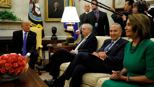 President Donald Trump meets with Senate Majority Leader Mitch McConnell (2nd L), Senate Democratic Leader Chuck Schumer (2nd R), House Minority Leader Nancy Pelosi (R) and other congressional leaders in the Oval Office of the White House in Washington, September 6, 2017.