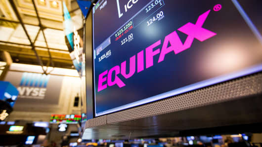 A monitor displays Equifax Inc. signage on the floor of the New York Stock Exchange (NYSE) in New York, U.S., on Friday, Sept. 8, 2017.
