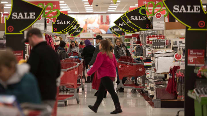 Sale signs hang above shoppers at a Target Corp. store.