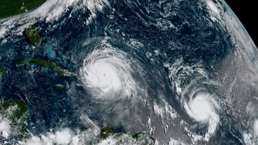 Hurricane Irma (L) and Hurricane Jose are pictured in the Atlantic Ocean on September 7, 2017.