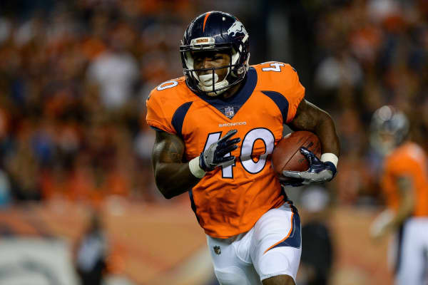 Running back Juwan Thompson #40 of the Denver Broncos rushes in the second half during a preseason NFL game against the Arizona Cardinals at Sports Authority Field at Mile High on August 31, 2017 in Denver, Colorado.