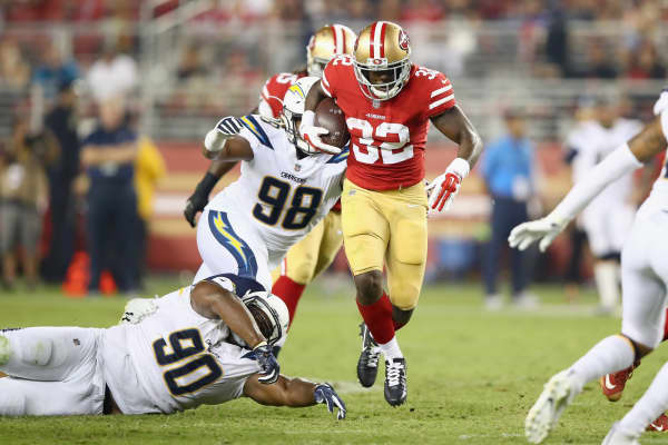 Ryan Carrethers #90 of the Los Angeles Chargers tries to tackle Joe Williams #32 of the San Francisco 49ers at Levi's Stadium on August 31, 2017 in Santa Clara, California.