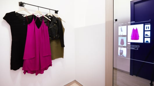 Dressing rooms in Rebecca Minkoff's flagship NYC store have interactive mirrors that can adjust lighting and contact sales associates.