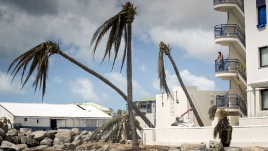 This handout photograph provided courtesy of the Dutch Department of Defense on September 8, 2017 shows a man looking on over the devastion of Hurricane Irma on the Dutch Caribbean island of Sint Maarten.