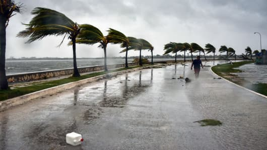A man walks against heavy winds after the passage of Hurricane Irma, at Caibarien, Villa Clara province, 330km east of Havana, on September 9, 2017.