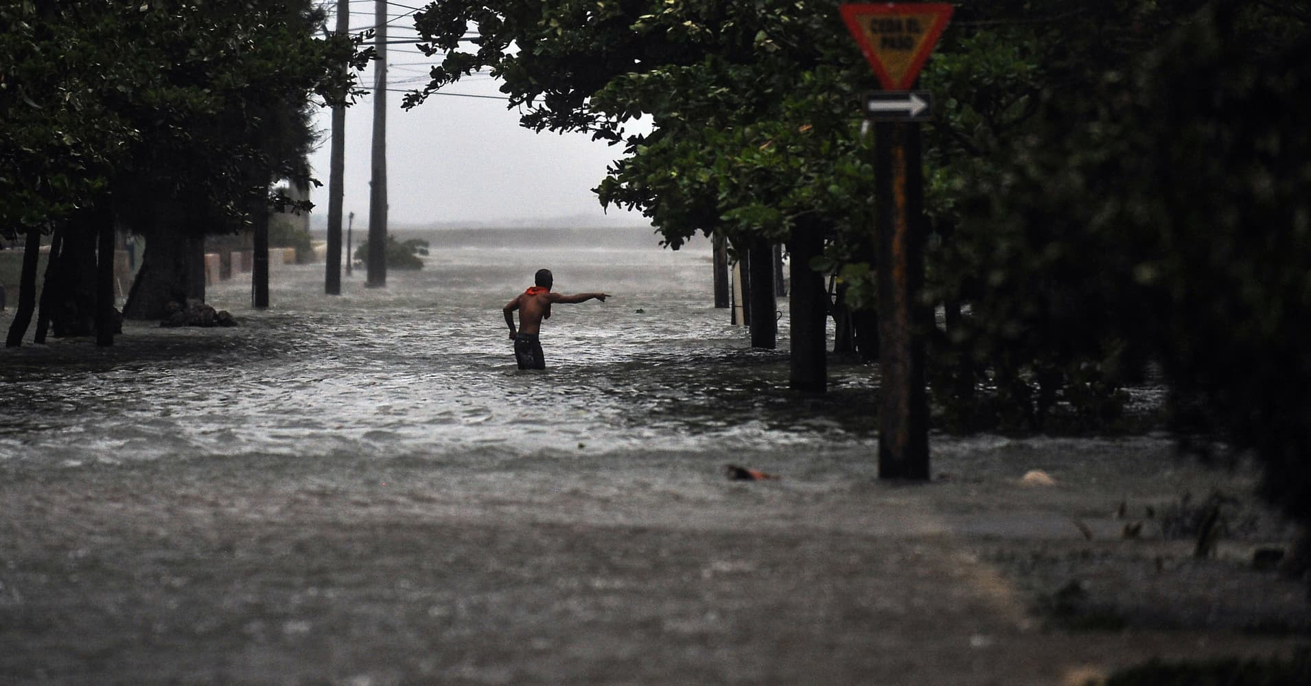 A man wades through a flooded street during the passage of Hurricane Irma, in Havana, on September 9, 2017.