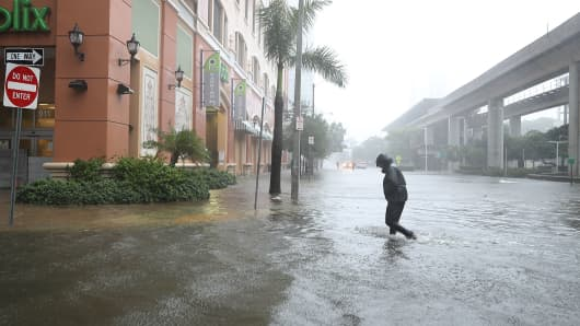 A person walks through a flooded street in the Brickell area of downtown as Hurricane Irma passes through on September 10, 2017 in Miami, Florida.