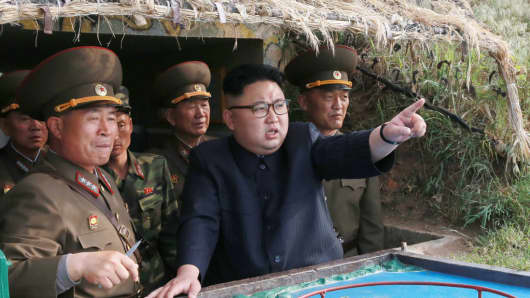North Korean leader Kim Jong Un inspects the defense detachment on Jangjae Islet in this undated picture released by the country's official news agency on May 5, 2017.