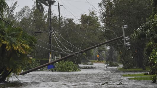 A downed utility pole is seen as Hurricane Irma passes through on September 10, 2017 in Hollywood, Fl.