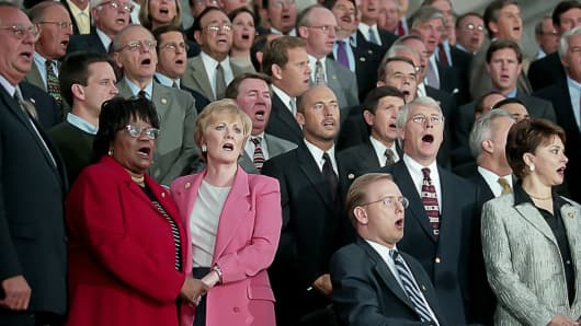 Senators and Representatives gather on the east steps of the Capital Building and sing 'God Bless America' to denounce the act of terrorism on America, in Washington, DC September 11, 2001.