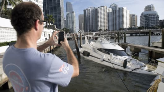Partially submerged boats caused by Hurricane Irma sit in the water in a marina in downtown Miami, Florida, September 11, 2017.