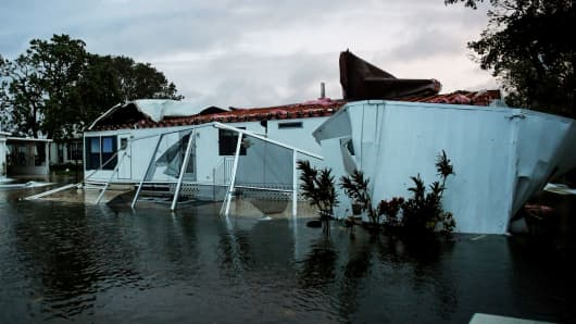 Flood water from Hurricane Irma surround a damaged mobile home in Bonita Springs, Florida, September 10, 2017.