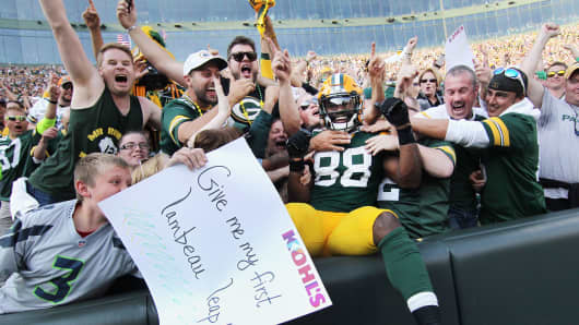 Ty Montgomery of the Green Bay Packers celebrates with fans after scoring a touchdown during the third quarter against the Seattle Seahawks at Lambeau Field on September 10, 2017 in Green Bay, Wisconsin.