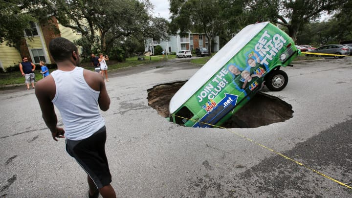 A van is seen in a sinkhole from Hurricane Irma on Monday, Sept. 11, 2017 in Winter Springs, Fla.