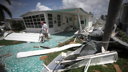 Steve Slonan inspects a friend's home after Hurricane Irma hit the area on September 11, 2017 in East Naples, Florida.