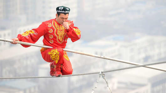 Dawazi performer Saimaiti Aishan on a tightrope 190 meters above the ground during a performance at Wanda Center on March 5, 2015 in Taiyuan, Shanxi province of China.