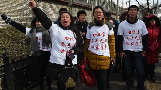 Investors in Chinese online peer-to-peer lender Ezubao protest in Beijing on February 4, 2016.