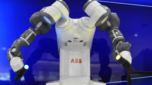 Collaborative dual-arm robot YuMi is pictured at the Swiss automation group ABB booth at the Hannover Messe industrial trade fair in Hanover, central Germany on April 13, 2015.