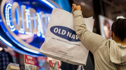 A customer lifts a shopping bag at an Old Navy store in San Francisco.