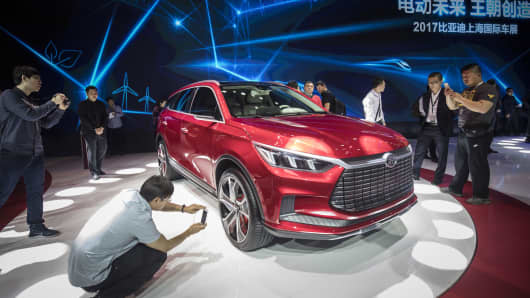Attendees take photographs of a BYD Dynasty SUV concept vehicle at the Auto Shanghai 2017 vehicle show in Shanghai last April.