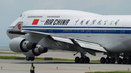 An Air China Boeing 747-400 aircraft transporting China's President Xi Jinping taxis for departure from Hong Kong's international airport on July 1, 2017.