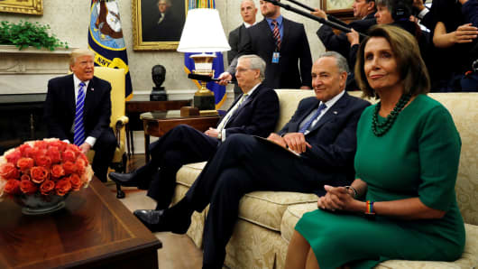 President Donald Trump meets with Senate Majority Leader Mitch McConnell (L), U.S. Senate Democratic Leader Chuck Schumer (2nd R), House Minority Leader Nancy Pelosi (R) and other congressional leaders in the Oval Office of the White House in Washington, September 6, 2017.