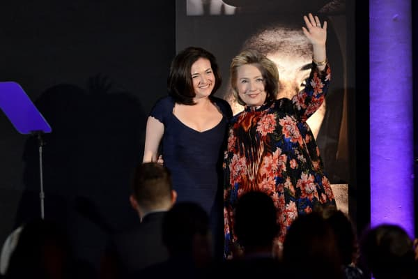 Sheryl Sandberg and Hillary Clinton onstage at the Women for Women 20th Anniversary Gala celebration at the American Museum of Natural History on December 3, 2013 in New York City.