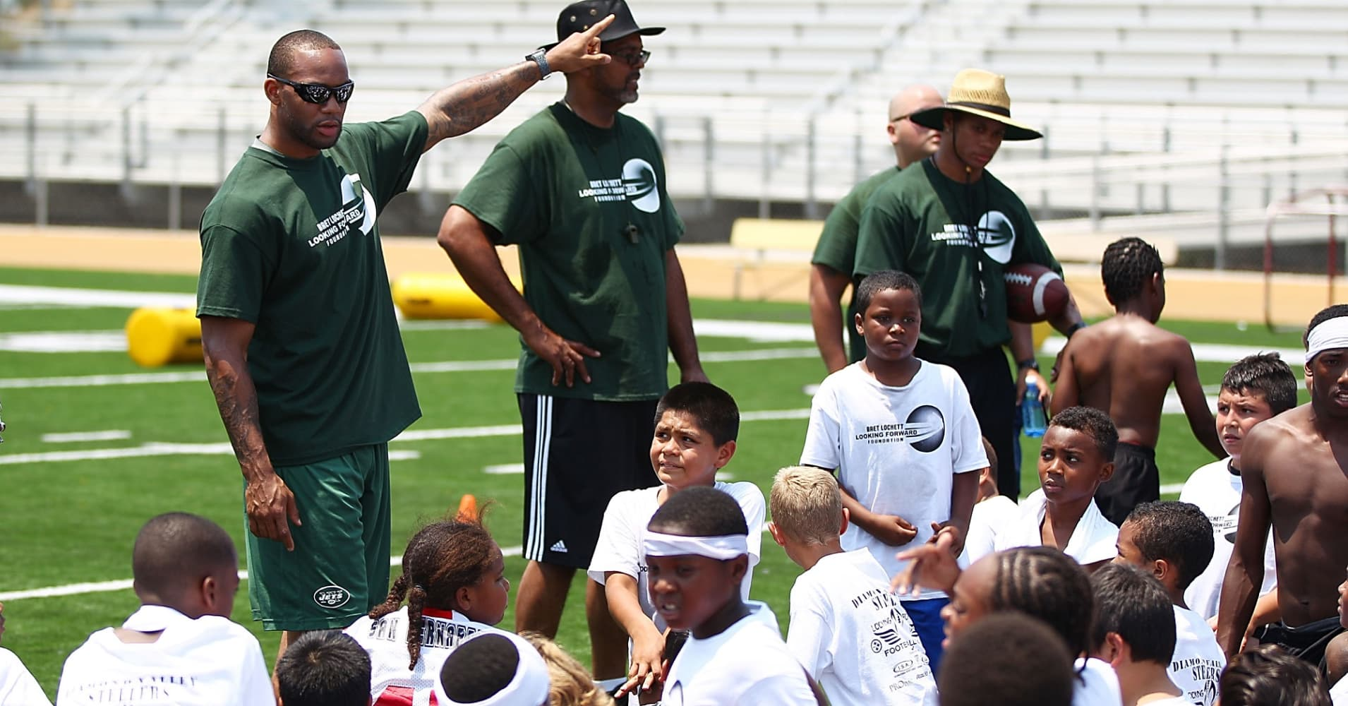 Former NFL New York Jets player Bret Lockett hosts a charity football camp at Diamond Bar High School