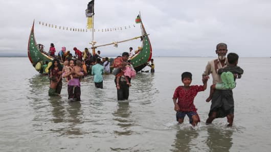 Rohingya Muslims, escaping from ongoing military operations in Myanmar's Rakhine state, flee to Bangladesh by boat on September 12, 2017.