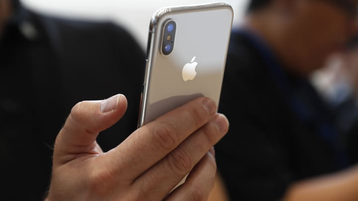 An attendee checks out a new iPhone X during an Apple launch event in Cupertino, California, U.S. September 12, 2017.