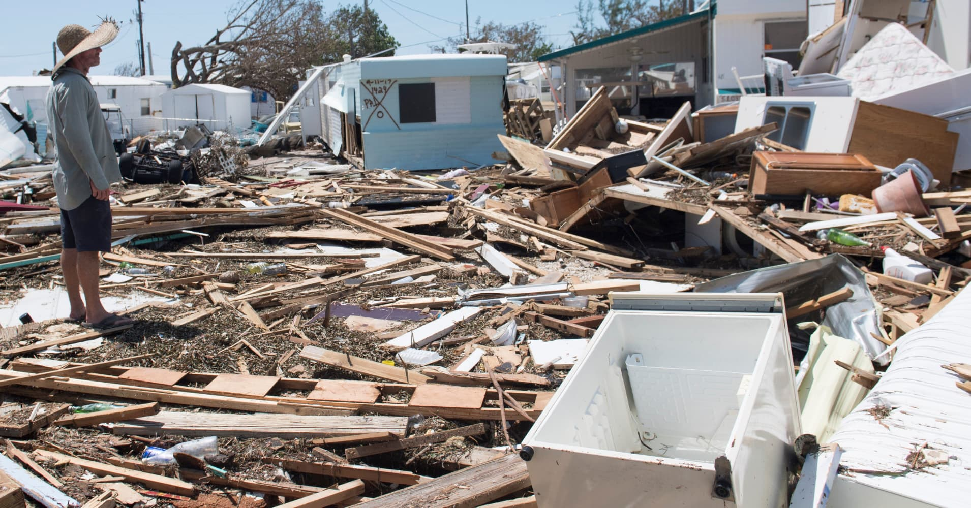 Bill Quinn surveys the damage caused to his trailer home from Hurricane Irma at the Seabreeze Trailer Park in Islamorada, in the Florida Keys, September 12, 2017.