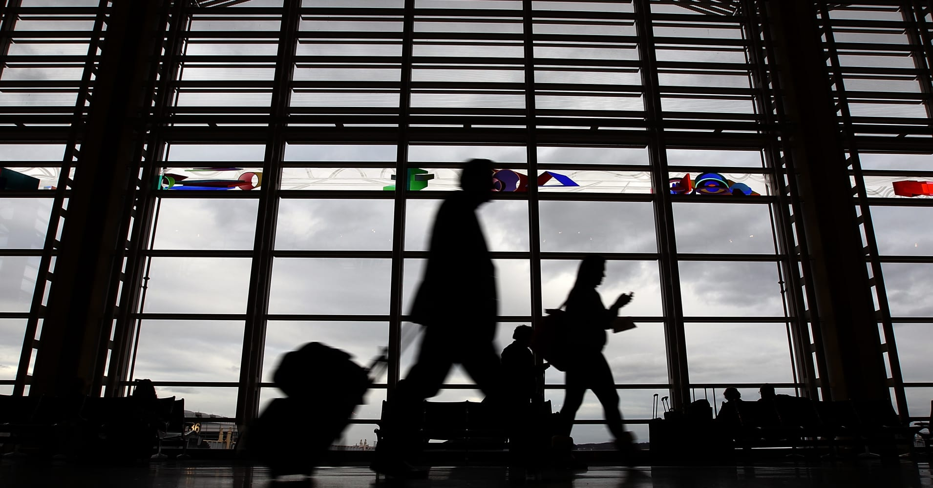 Travelers make their way to flights in the concourse of Ronald Reagan Washington National Airport