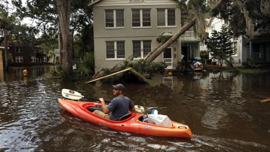Joshua Young takes some of his personal belonging out by kayak after flooding hit his apartment building during Hurricane Irma on September 12, 2017 in the San Marco area of Jacksonville, Florida.