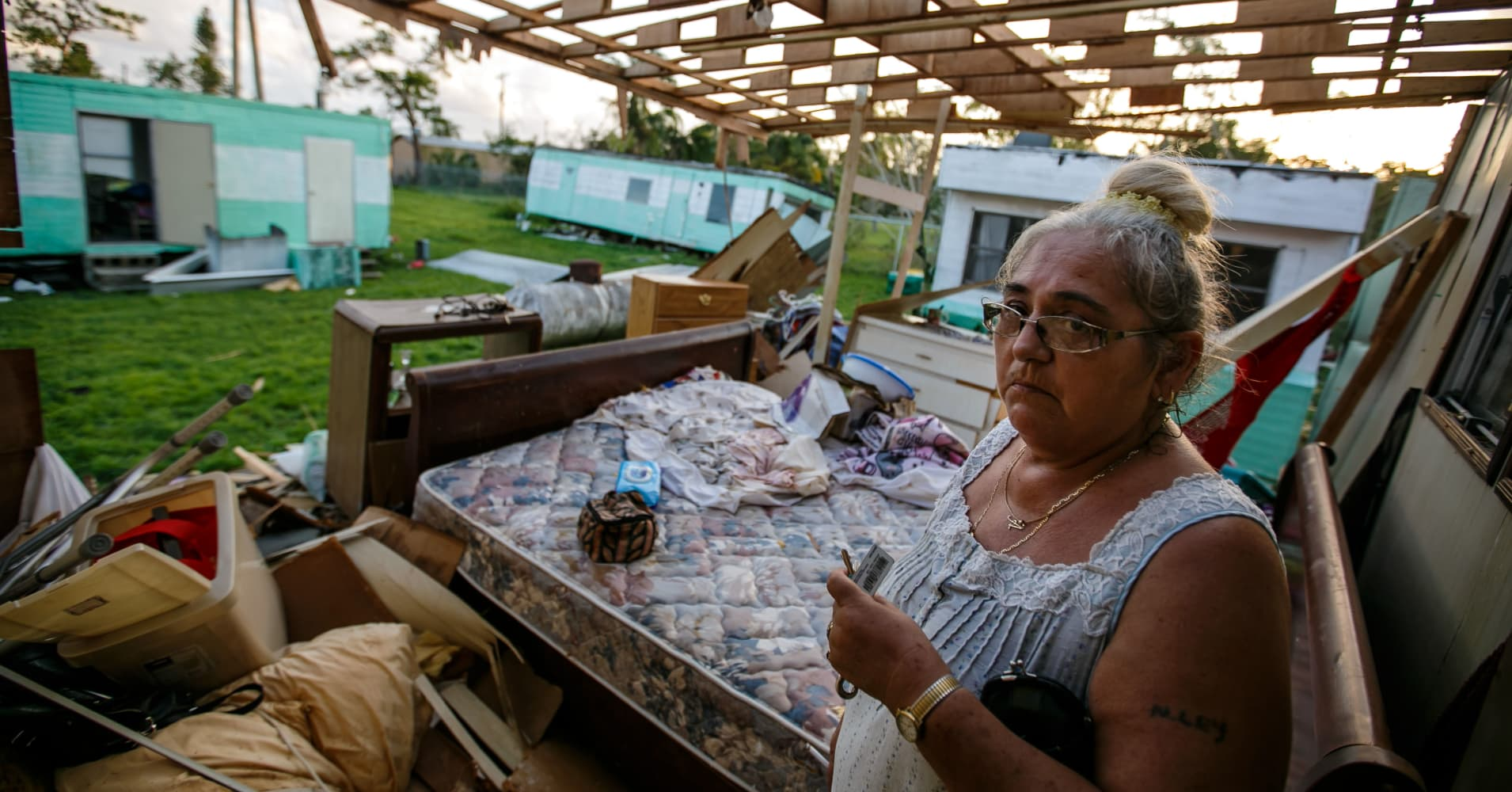 Alice Barber gets emotional as she surveys the damage caused by Hurricane Irma to her trailer home in Immokalee, Fla., on Sept. 11, 2017.